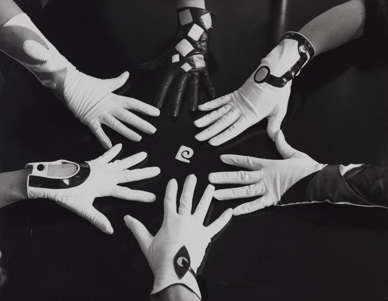 Gloves around the Pierre Cardin _Escargot_ logo  mid-1960s. Photograph by Yoshi Takata